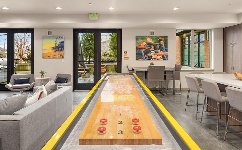 Amenity lounge with shuffleboard & kitchen.